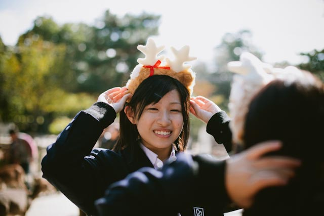 student with a deer headband - the cat you and us