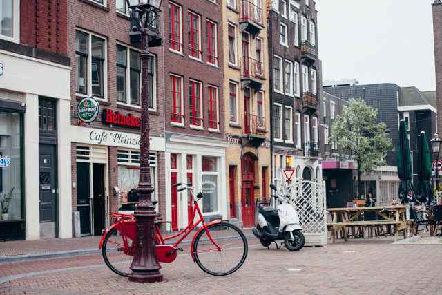 red bike, red buildings - The cat, you and us