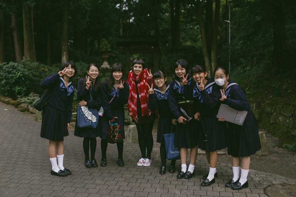 Group of Japanese teenage students at Kamakura - The cat, you and us
