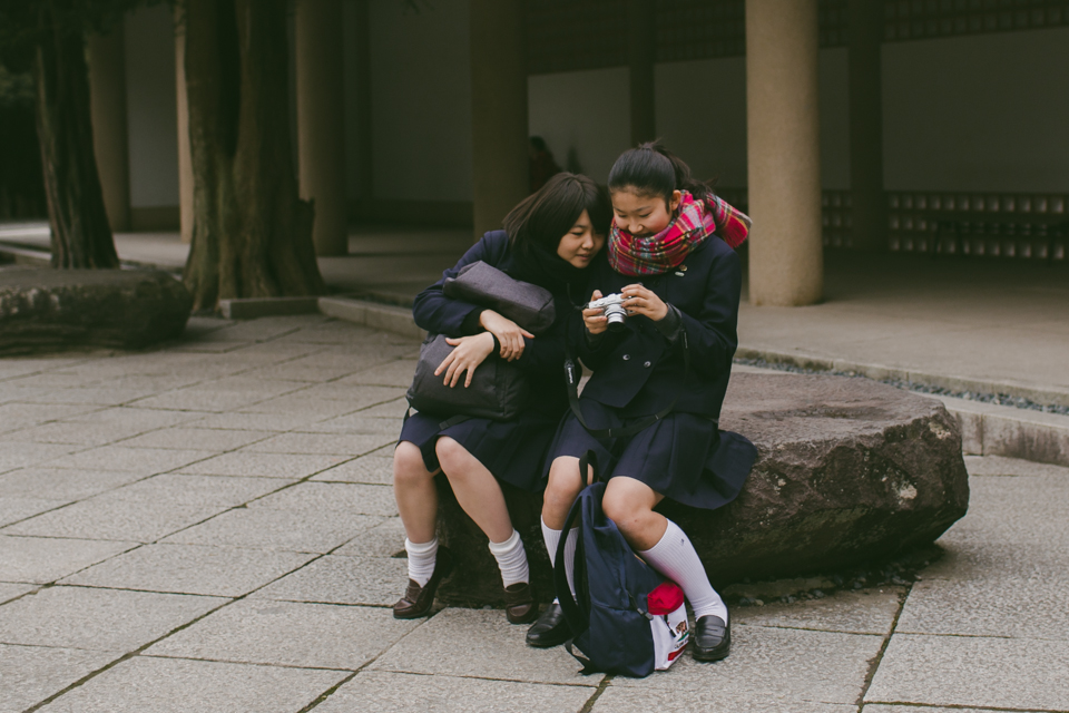 Japanese teenage students taking pictures - The cat, you and us