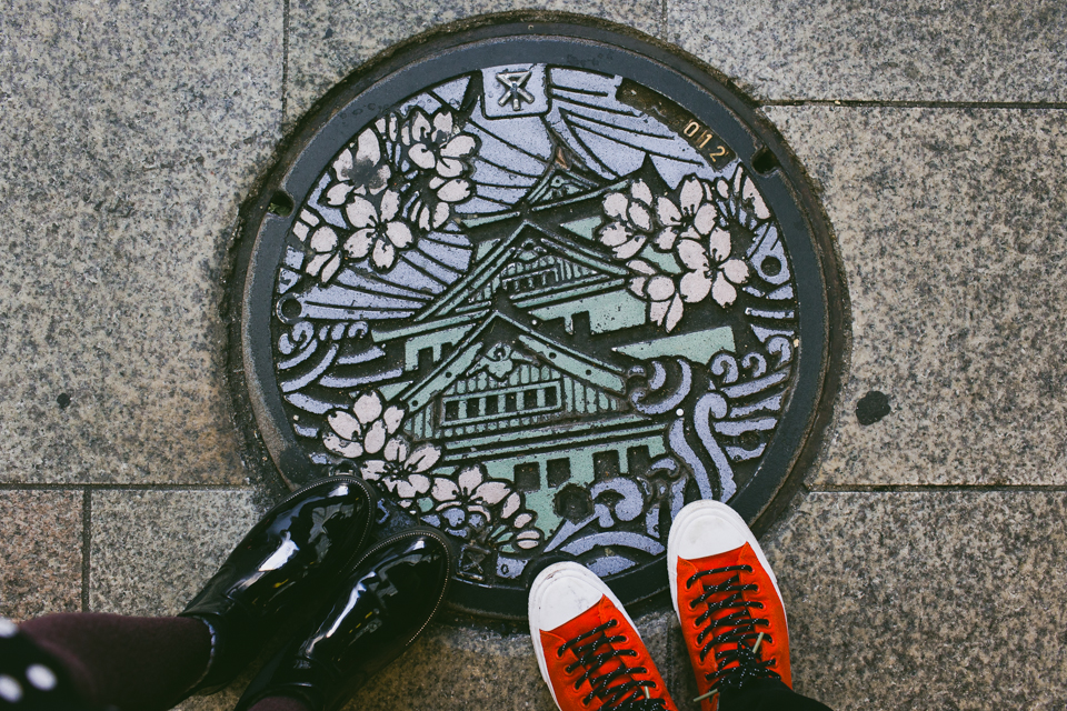 Osaka castle manhole - The cat, you and us