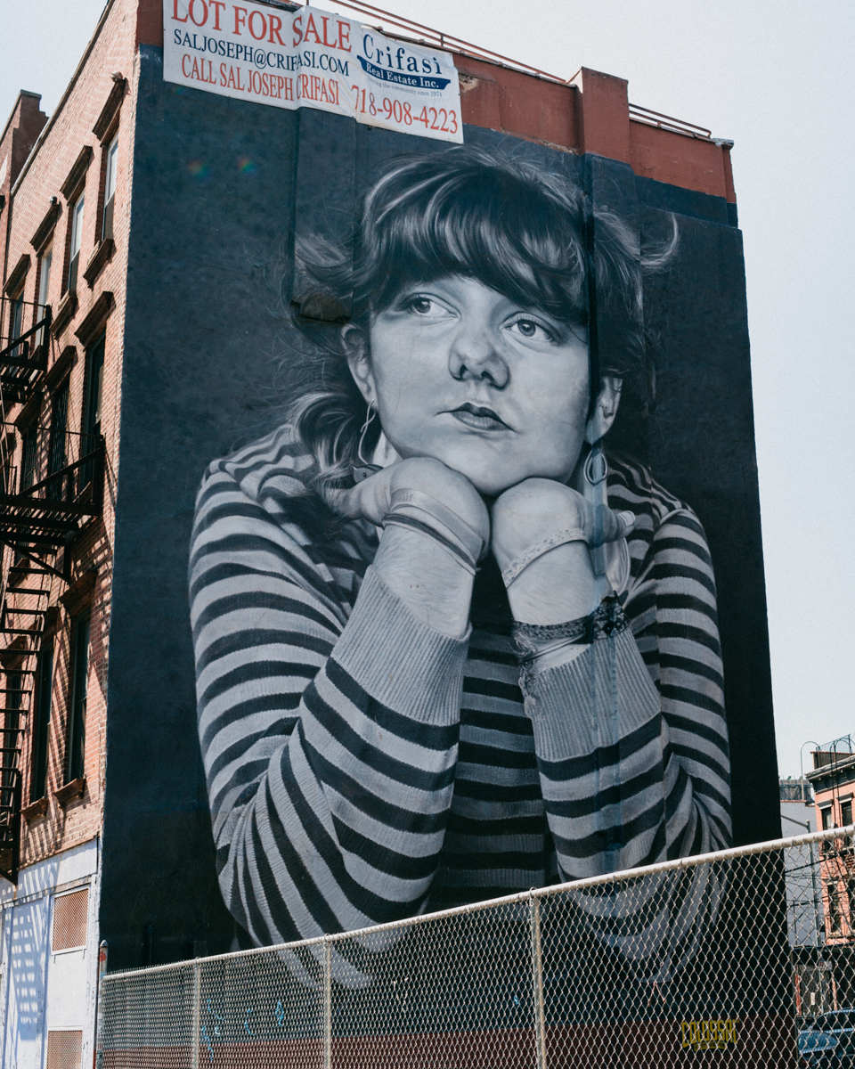 Girl with a striped sweater graffiti in Brooklyn - The cat, you and us